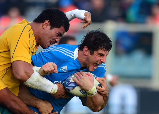Italy's flanker Alessandro Zanni is tackled by Sitaleki Timani (left)