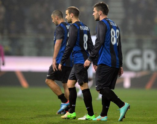 Inter's players Walter Samuel Rodrigo Palacio (C) and Marko Livaja (R) leave the pitch at the end of  the match