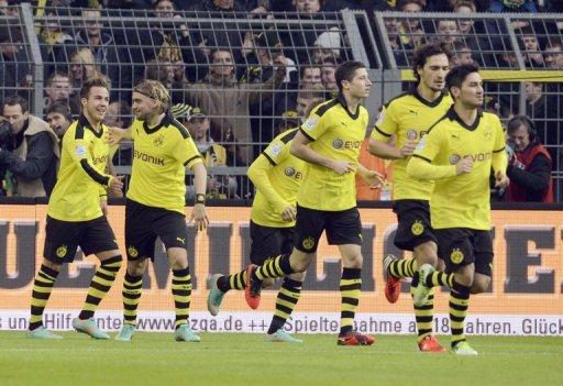Dortmund enjoyed their third consecutive away win with goals by Marco Reus and Poland striker Robert Lewandowski