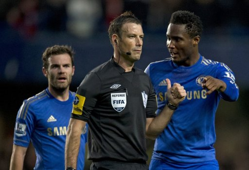 Chelsea's John Mikel Obi (R) talking with referee Mark Clattenburg in October