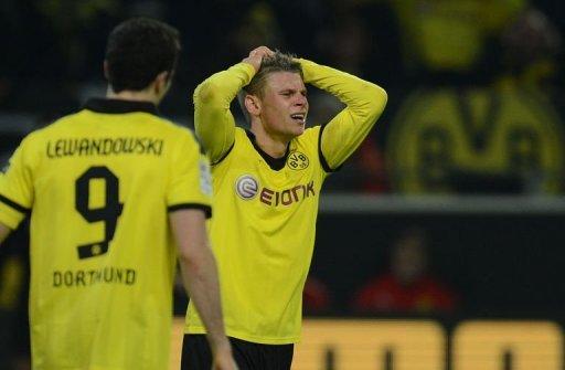 Dortmund's Lukasz Piszczek reacts after the match