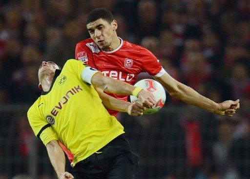 Duesseldorf's Leon Balogun (R) and Dortmund's Sebastian Kehl