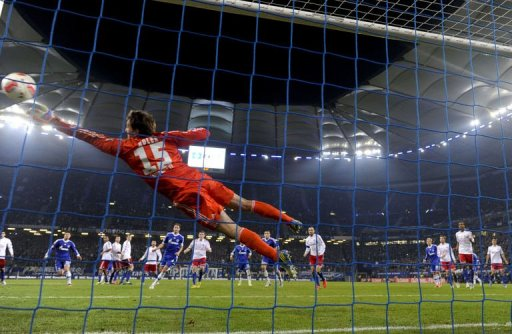 Hamburg's goalkeeper Rene Adler saves a free-kick against Schalke 04 on November 27