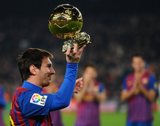 Barcelona's Lionel Messi shows his Ballon d'Or Trophy in January