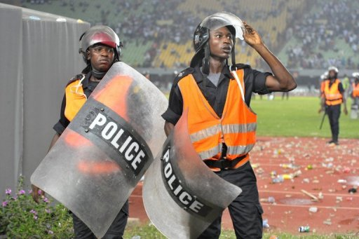 Senegalese police look on as fans rampage at Leopold Sedar Senghor stadium in Dakar, in October