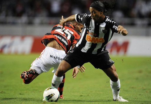 There have been occasional flashes of brilliance from Ronaldinho (right)