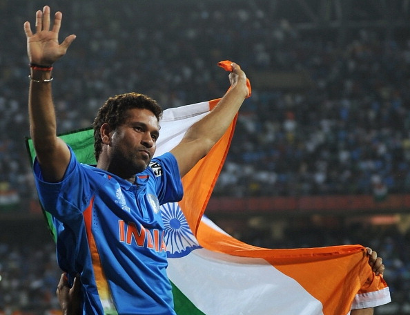 Indian cricketer Sachin Tendulkar waves