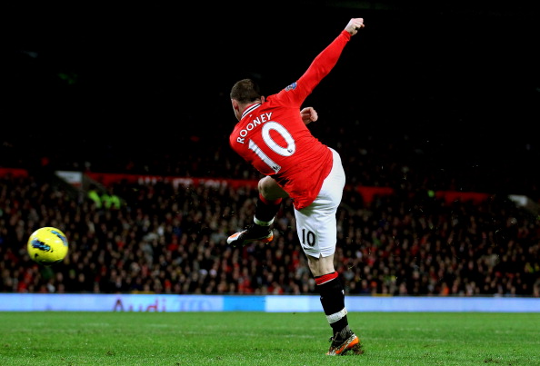 MANCHESTER, ENGLAND - DECEMBER 10:  Wayne Rooney of Manchester United lashes a shot towards the Wolves goal to score his team's fourth goal during the Barclays Premier League match between Manchester United and Wolverhampton Wanderers at Old Trafford on December 10, 2011 in Manchester, England.