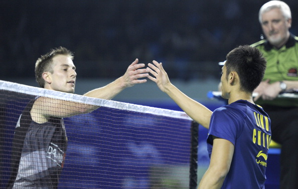 Lin Dan of China (R) shakes hands with P