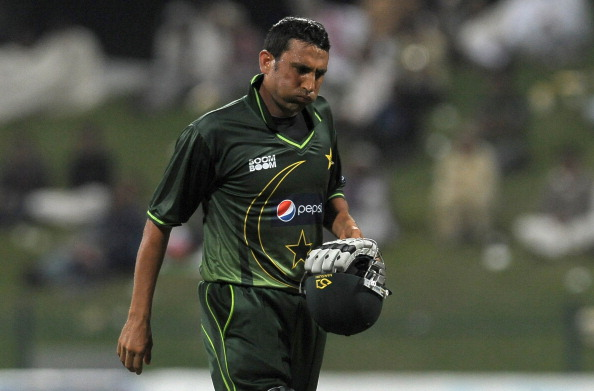 Pakistan's Younis Khan walks back to the