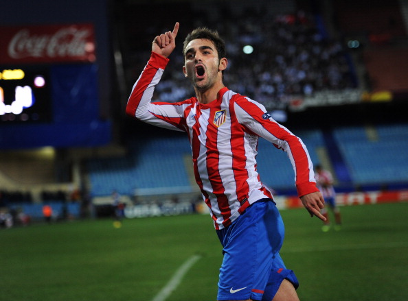 MADRID, SPAIN - MARCH 08:  Adrian Lopez of Club Atletico de Madrid celebrates scoring his sides third goal during the UEFA Europa League round of 16 first leg match between Club Atletico de Madrid and Besiktas JK at the Vincente Calderon stadium on March 8, 2012 in Madrid, Spain.