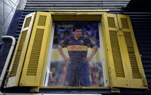 A poster of midfielder Juan Roman Riquel