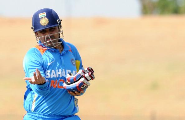 Indian cricketer Virender Sehwag walks b