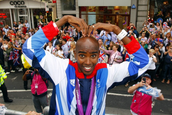 LONDON, ENGLAND - SEPTEMBER 10:  Gold Medal winner athlete Mo Farah performs a 'mobot' during the London 2012 Victory Parade for Team GB and Paralympic GB athletes on September 10, 2012 in London, England.