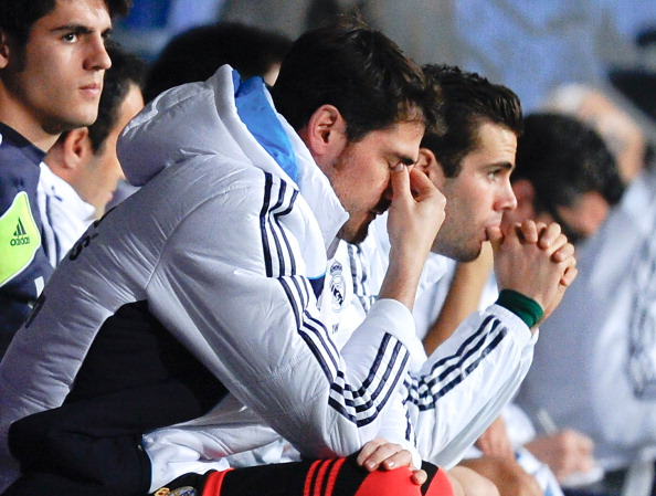 MALAGA, SPAIN - DECEMBER 22:  Iker Casillas of Real Madrid CF reacts dejected on the bench after Roque Santa Cruz of Malaga CF scored his team's second goal during the La Liga match between Malaga CF and Real Madrid CF at La Rosaleda Stadium on December 22, 2012 in Malaga, Spain.