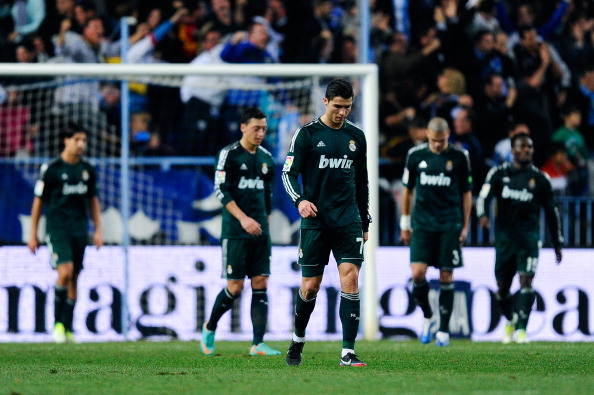 MALAGA, SPAIN - DECEMBER 22:  Cristiano Ronaldo of Real Madrid CF reacts dejected afte Roque Santa Cruz of Malaga CF scored his team's third goal during the La Liga match between Malaga CF and Real Madrid CF at La Rosaleda Stadium on December 22, 2012 in Malaga, Spain.