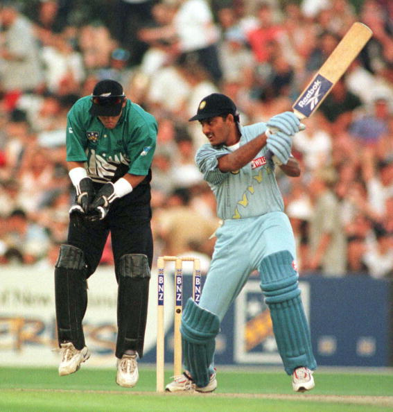 India's Mahommad Azharuddin bats infront of New Ze