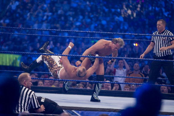 "HOUSTON, TX - APRIL 5:  (L-R) Former professional wrestler Ricky ""The Dragon"" Steamboat gets thrown to the mat by WWE Superstar Chris Jericho during WrestleMania 25 at Reliant Stadium on April 5, 2009 in Houston, Texas."