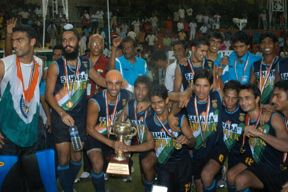 Indian Field Hockey players pose with their trophy and medals as they celebrate their win over Korea in the final match at the seventh Asia Cup Hockey tournament in Chennai, 09 September 2007. India defeated Korea 7-2.