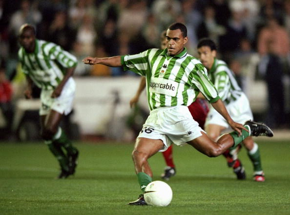 Denilson of Real Betis scores a penalty