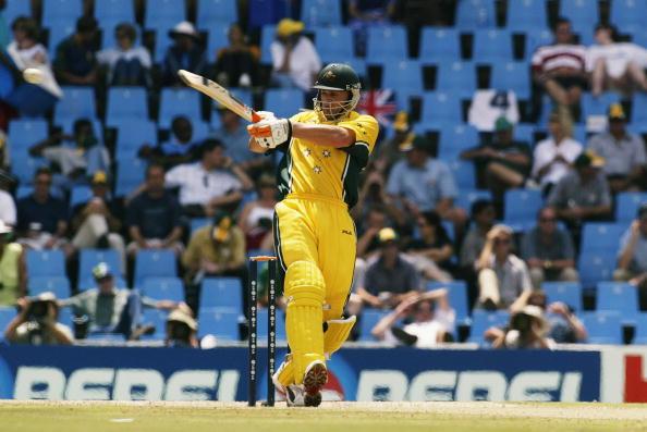 Adam Gilchrist of Australia hits a six