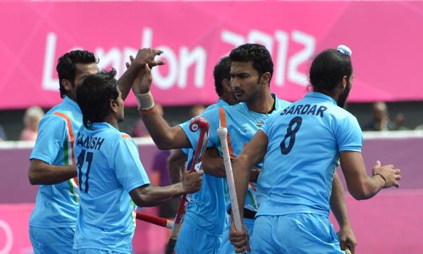 Teammates congratulate Raghunath Vr (C)