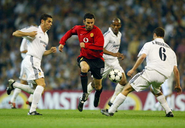 Ryan Giggs of Manchester United and Fernando Hierro and Ivan Helguera of Real Madrid