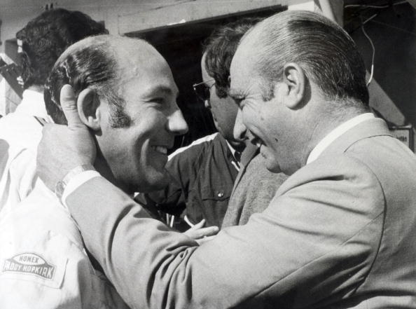 Sport Motor Racing. pic: 22nd August 1968. Nuerburgring, Germany. Famous Argentine former world champion racing driver Juan Fangio has a friendly greeting for British ace Stirling Moss, left.