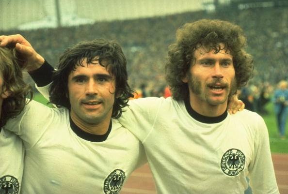 7 July 1974:  Gerd Muller (left) and Breitner (right) of West Germany celebrate after they win the World Cup Final against Holland