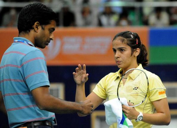 Indian badminton player Saina Nehwal (R)