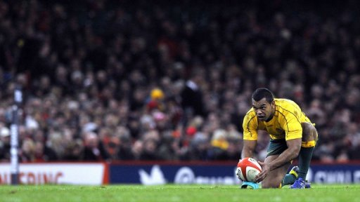 Australia's fly half Kurtley Beale lines up a penalty kick