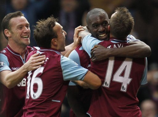 Carlton Cole (second-right) celebrates his equaliser
