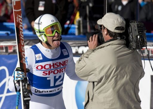 Matteo Marsaglia of Italy sticks his tongue out at the cameraman after winning