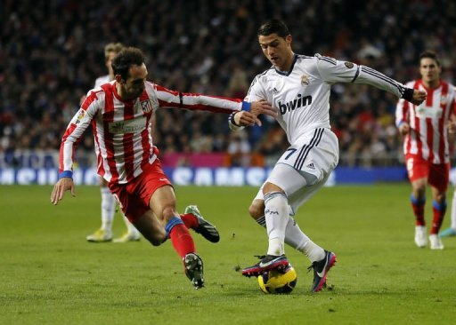 Real Madrid's Cristiano Ronaldo (R) responded on 15 minutes with a free-kick from 30 yards which nestled in the corner