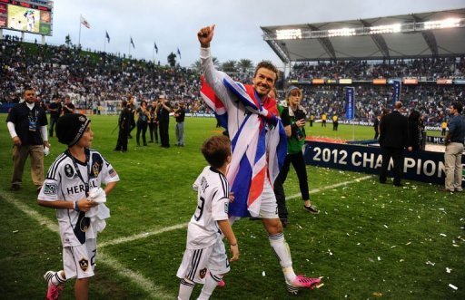 David Beckham salutes the fans at the end of his last match for Los Angeles Galaxy