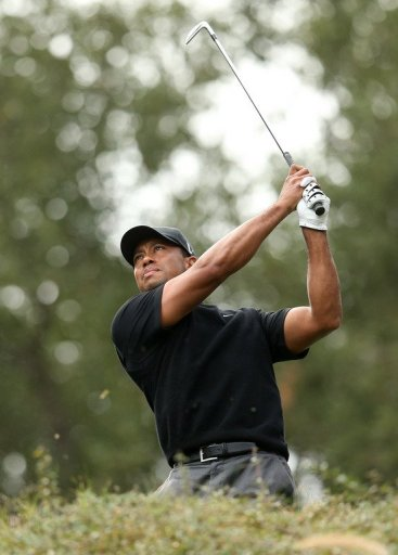 Tournament host Tiger Woods carded his second straight 69 at the Sherwood Country Club