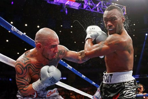 Miguel Cotto (L), a three-division world champion, fell to 37-4 with 30 wins inside the distance