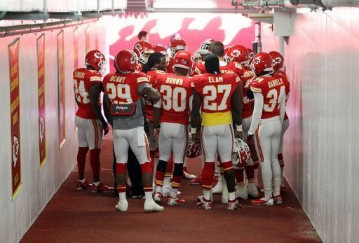 Kansas City Chiefs players huddle in prayer in the tunnel to the field prior to the game against the Carolina Panthers