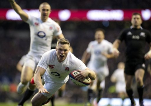 England wing Chris Ashton goes over the try line as New Zealand went down 38-21 at Twickenham