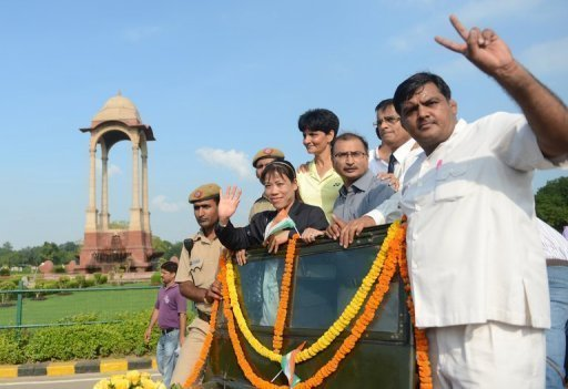 London Olympics bronze medallist Mary Kom (2ndL) on a parade in August 2012
