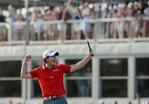 Rory McIlroy celebrates winning the 94th PGA Championship