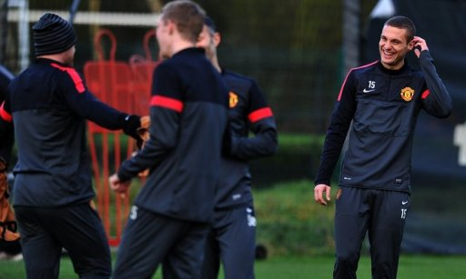 Vidic (R) trained with United on Tuesday morning ahead of the Group H encounter at Old Trafford