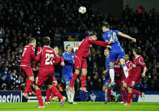 Chelsea's defender Gary Cahill scores the third goal