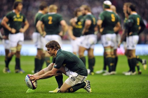 S. Africa's fly-half Pat Lambie prepares the ball before kicking a penalty at a match against England in November 2012