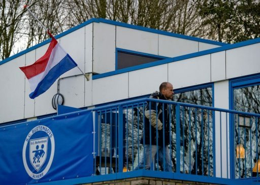 A flag flies half-mast on December 4 at the clubhouse of the Dutch football club SC Buitenboys in Almere