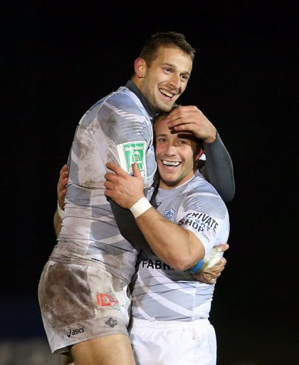 Castres players Romain Martial (L) and Marc Andreu celebrate following their victory