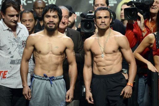 Manny Pacquiao (L) and Juan Manuel Marquez pose during the official weigh-in