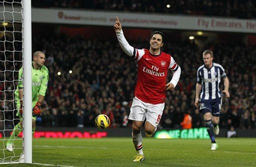 Arsenal's midfielder Mikel Arteta celebrates scoring his second penalty