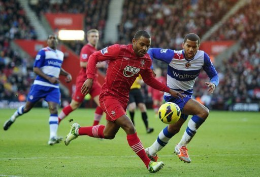 Southampton's midfielder Jason Puncheon (L) clashes with Reading's defender Adrian Mariappa