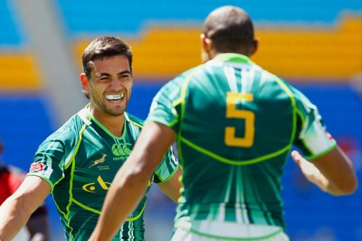 South Africa's Chris Dry (L) congratulates teammate Cornal Hendricks on his try